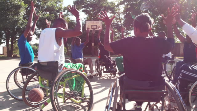 the victory parade pledge performed by physically challenged basketball team players - wheelchair basketball stock videos & royalty-free footage