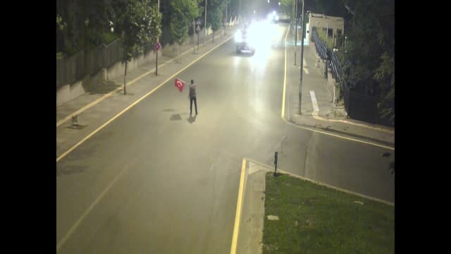 The video footage of a city surveillance camera on night of July 15 shows that a citizen resists to armored vehicles by waving Turkish flag in front...