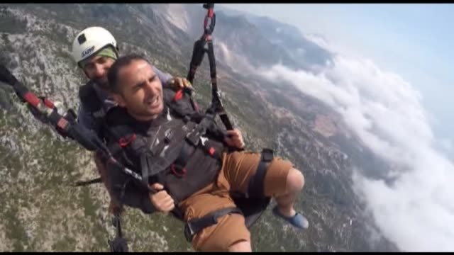 the video footaged by action camera shows that a tourist screams and shouts while paragliding in the sky at over 2000 feet in fethiye district of... - mugla province stock videos and b-roll footage