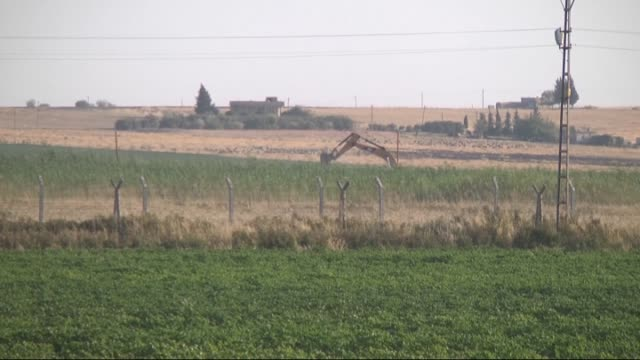 The video footaged from Sanliurfa Turkish side of the border on July 24 2015 shows that ditchers in Tal Abyad under control of SyrianKurdish...