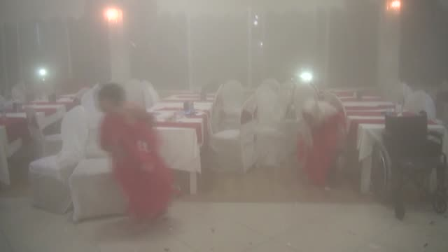vídeos de stock, filmes e b-roll de the video footaged on august 17 by security camera of a wedding hall shows that suspected pkk terrorists have launched a car bomb attack on a police... - negativo tipo de imagem