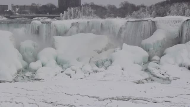the video shot in ontario canada shows views from niagara falls which is partially frozen due to the extreme cold weather conditions on february 22... - niagarafälle stock-videos und b-roll-filmmaterial