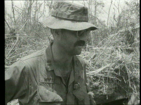 the vietnam collection 1 tx captain f wyse interview about military operation to capture vietcong trapped in foxhole sot / dead body searched by us... - ベトコン点の映像素材/bロール