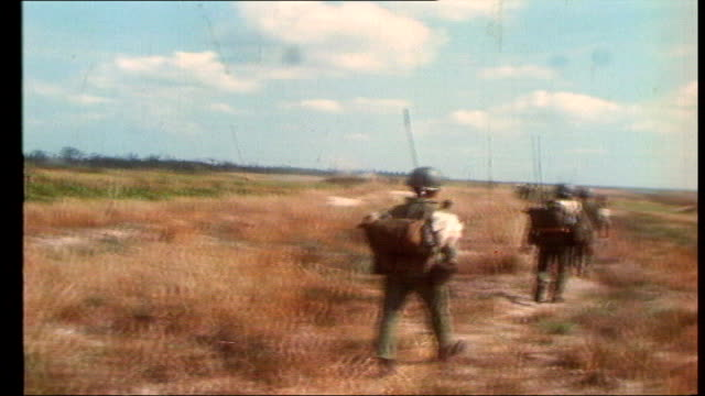 the vietnam collection 2; tx 14.4.1972 vietnam: highway 13: ext south vietnamese troops shelling vietcong positions / body dragged from bunker /... - south vietnam stock videos & royalty-free footage