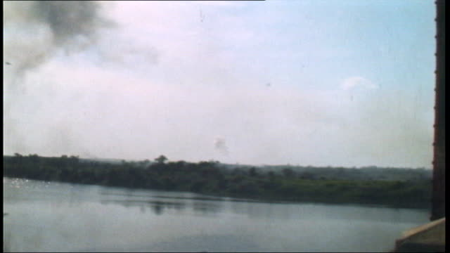 the vietnam collection 2; tx 5.5.1972 quang tri area: plane bombing countryside / damaged rail bridge / major d. price interview sot / deserted... - bombenanschlag stock-videos und b-roll-filmmaterial