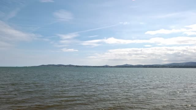 the view across dublin bay to south dublin on a sunny day - film moving image stock videos & royalty-free footage