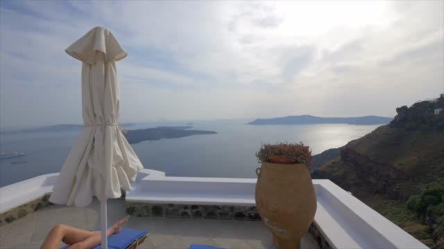 the view from a hotel apartment deck, traveling in santorini, greece, europe. - slow motion - santorini video stock e b–roll