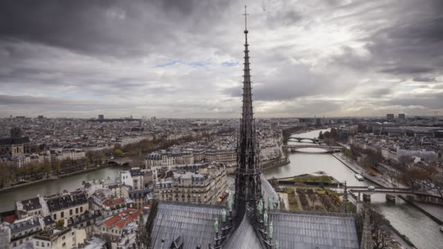 stockvideo's en b-roll-footage met the view from notre dame de paris cathedral over the city of paris, france. - torenspits