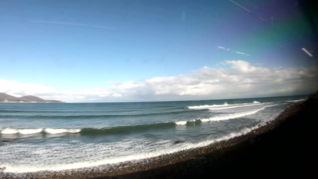 the view from the train window overlooking the sea. - practising stock videos & royalty-free footage