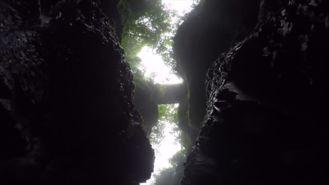 The view looking up a narrow canyon. - Slow Motion