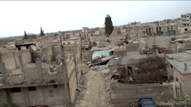 the view of damaged houses during the clashes between the islamic state of iraq and levant and kurdish armed troops in kobane city of syria, on... - isil konflikt stock-videos und b-roll-filmmaterial