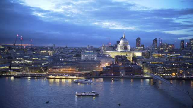 The view of St Paul's Cathedral, London at dusk, across the Thames from the Tate Modern Gallery.