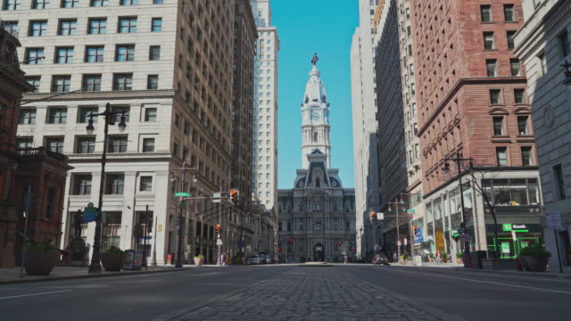 the view on philadelphia city hall from south broad street. upward camera motion. - pennsylvania stock videos & royalty-free footage