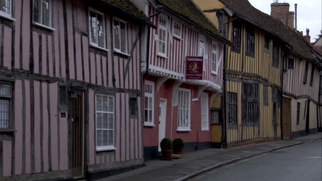the village of lavenham features a street lined with rows of quaint, medieval cottages. available in hd. - lavenham stock-videos und b-roll-filmmaterial