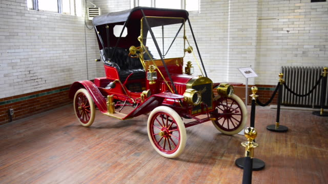 the vintage car is seen in casa loma which is a castle and mansion in the canadian city it the landmark is part of canada's heritage and a famous... - anno 1910 video stock e b–roll