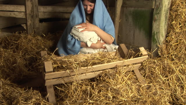 The Virgin Mary with baby Jesus in Stable (Christmas Story)