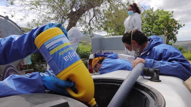 the volunteers preparing the disinfectant tank. volunteers disinfect the streets of the city during the coronavirus pandemic on april 20, 2020 in... - laundry detergent stock videos & royalty-free footage