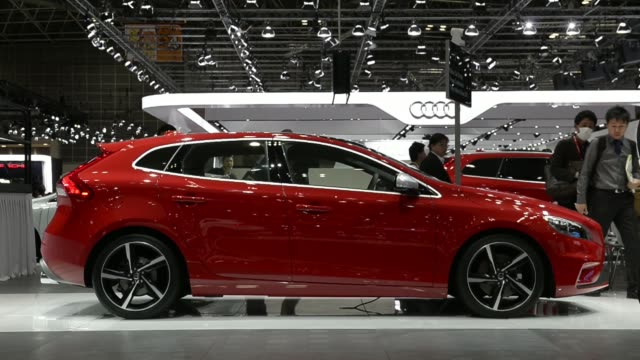The Volvo Cars V40 Cross Country vehicle is displayed at the 43rd Tokyo Motor Show 2013 in Tokyo Japan on Wednesday Nov 20 Volvo logos Volvo Cars V40...