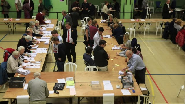 the votes are counted at the windrush leisure centre on october 21, 2016 in witney, england. the by-election in witney, oxfordshire was prompted by... - oxfordshire stock videos & royalty-free footage