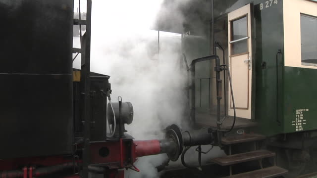 stockvideo's en b-roll-footage met the vsm train is heated with steam from the locomotive - kees van den burg