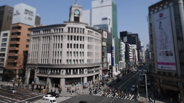 the wako co flagship store center stands in the ginza district of tokyo japan on monday march 20 people cross a road near the wako co flagship store... - ginza stock videos & royalty-free footage