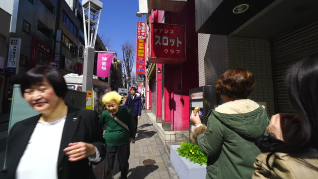tl the walking camera captures the kagurazaka shopping street in tokyo.there are many shops and restaurants along the street. - tradition stock videos & royalty-free footage