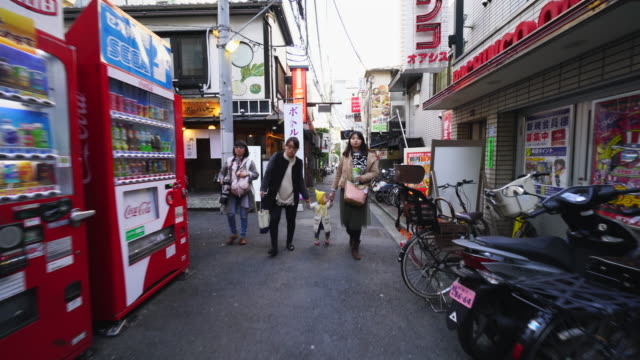 tl the walking camera going through the kagura kouji to narrow alleyway of michikusa yokocho in kagurazaka tokyo.there are many restaurants, bars and shops along the both side of alleyway. - kagura stock videos & royalty-free footage