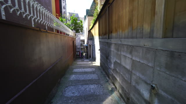 the walking camera going through the narrow stone stair alley, which alleyway is surrounded by high wall in kagurazaka tokyo.there is a ryotei restaurant maeda at the corner of the alleyway, and some other restaurants and bars at both side of alley. - corner stock videos & royalty-free footage