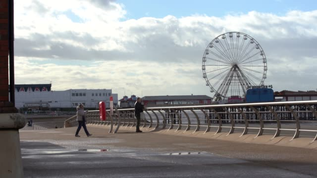 the walk-way right by the seafront as people walk by on september 29 in manchester, england. - water's edge stock videos & royalty-free footage