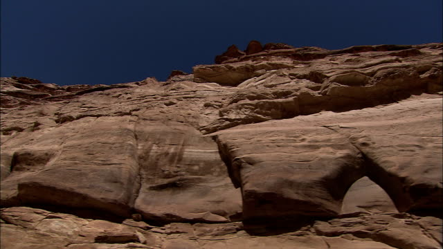 the walls of a sandstone canyon rise high into the sky. - sandstone stock videos & royalty-free footage