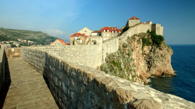 the walls of dubrovnik and adriatic sea (wide shot) - fort stock videos & royalty-free footage