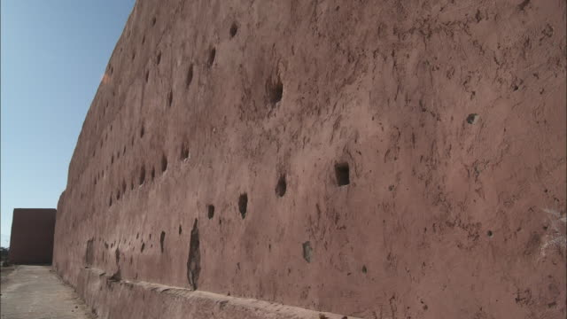 the walls of the medina in marrakech, morocco display many holes. - castle stock videos & royalty-free footage