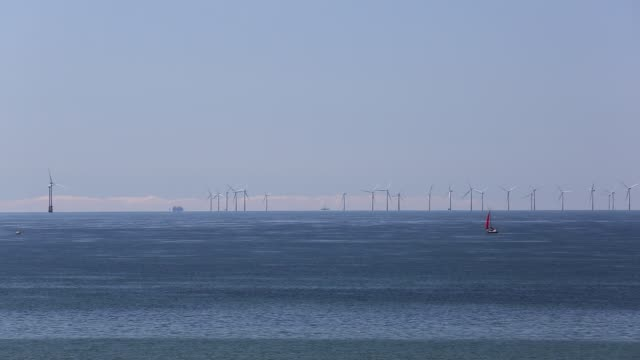 the walney offshore wind farm from walney island cumbria uk with none of the turbines turning - sailing boat stock videos & royalty-free footage