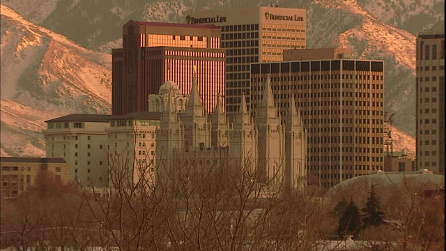 the wasatch mountains tower above the office buildings and temple of the church of jesus christ of latter-day saints in salt lake city. - mormonism stock videos & royalty-free footage