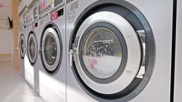 the washing machine is running - launderette stock videos & royalty-free footage