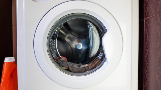 the washing machine washes clothes. timelapse - tumble dryer stock videos & royalty-free footage