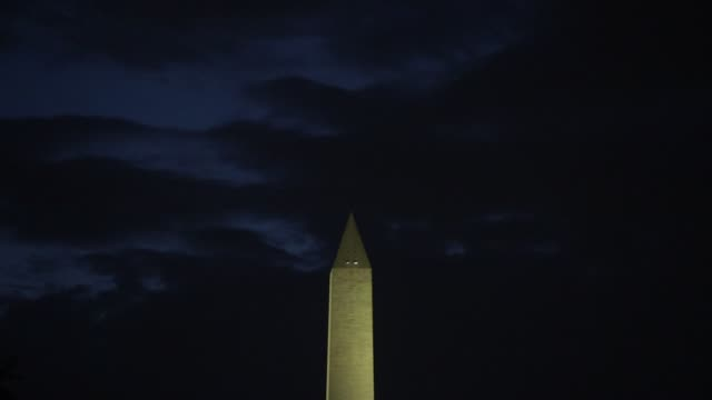 the washington monument is seen at the national mall april 7, 2020 in washington, dc. the district of columbia has joined other states and... - maryland stato video stock e b–roll