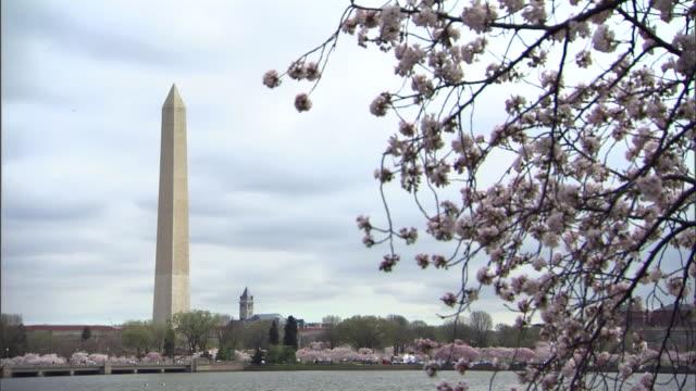 The Washington Monument rises above the Potomac River.