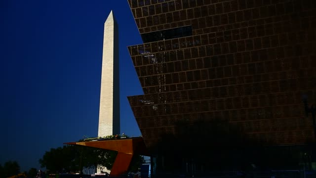 the washington monument stands past the national museum of african american history and culture under construction in washington, dc, us, on... - african american culture stock videos & royalty-free footage