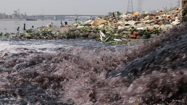 the waste from factories contaminating the water of the buriganga river in dhaka, bangladesh on march 15, 2021. the chemical waste from mills and... - toxic substance stock videos & royalty-free footage