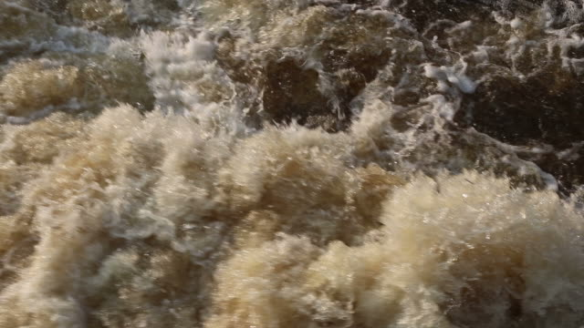the water flowed rapidly, boiling, splattered, and furiously. - furious stock videos & royalty-free footage