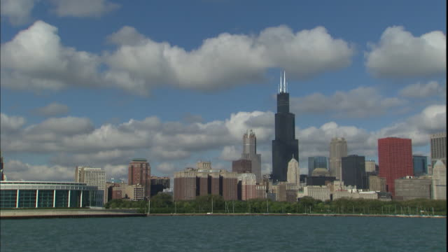 the water in lake michigan ripples in front of the chicago skyline. - two prudential plaza stock videos & royalty-free footage