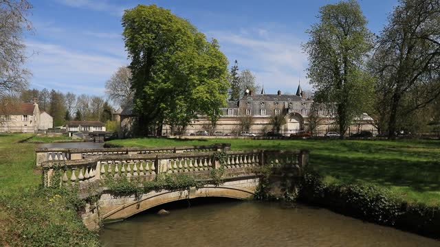 """the watercourse """"la launette"""" crosses the jean jacques rousseau park on a sunny spring day on april 22, 2021 in ermenonville, france. this... - daydreaming stock videos & royalty-free footage"""