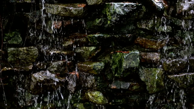 The waterfall at the wall in garden.