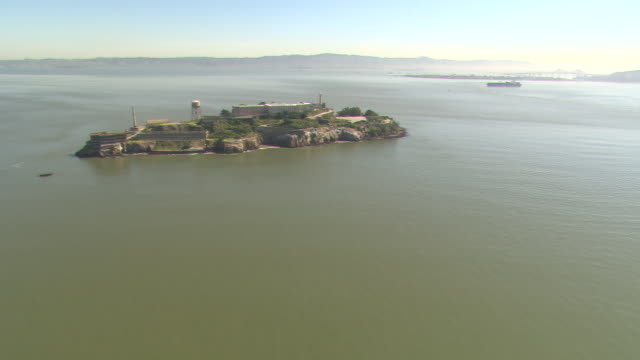 The waters of San Francisco Bay surround Alcatraz Island and prison.