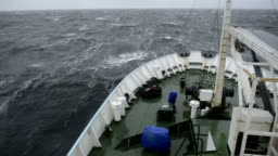 The wave breaks about the ship's nose