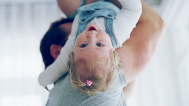 the wealthiest father has his arms full of love - baby girls stock videos & royalty-free footage