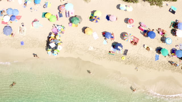 the weather is perfect for sun bathing - parasol stock videos & royalty-free footage