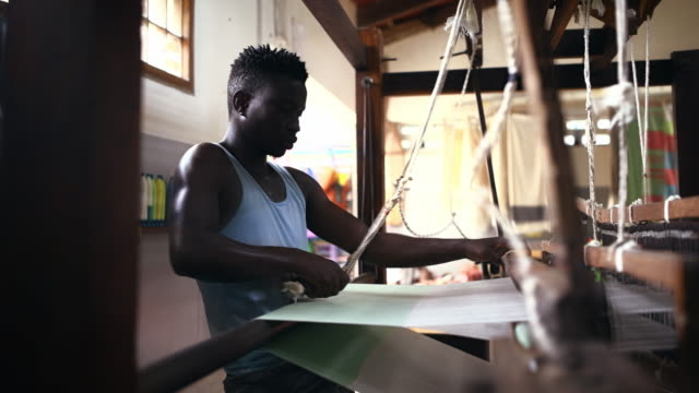 the weaving process is quite industrious - loom stock videos & royalty-free footage