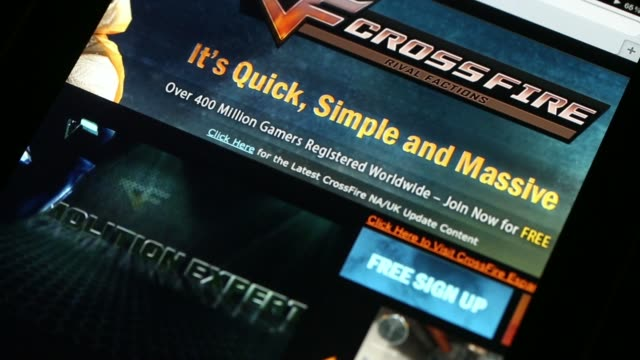 The website for CrossFire a video game developed by SmileGate Holdings controlled by Tencent Holdings Ltd is displayed on an Apple Inc iPad in an...